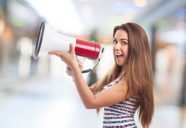 woman-smiling-with-a-megaphone_1149-715.jpg